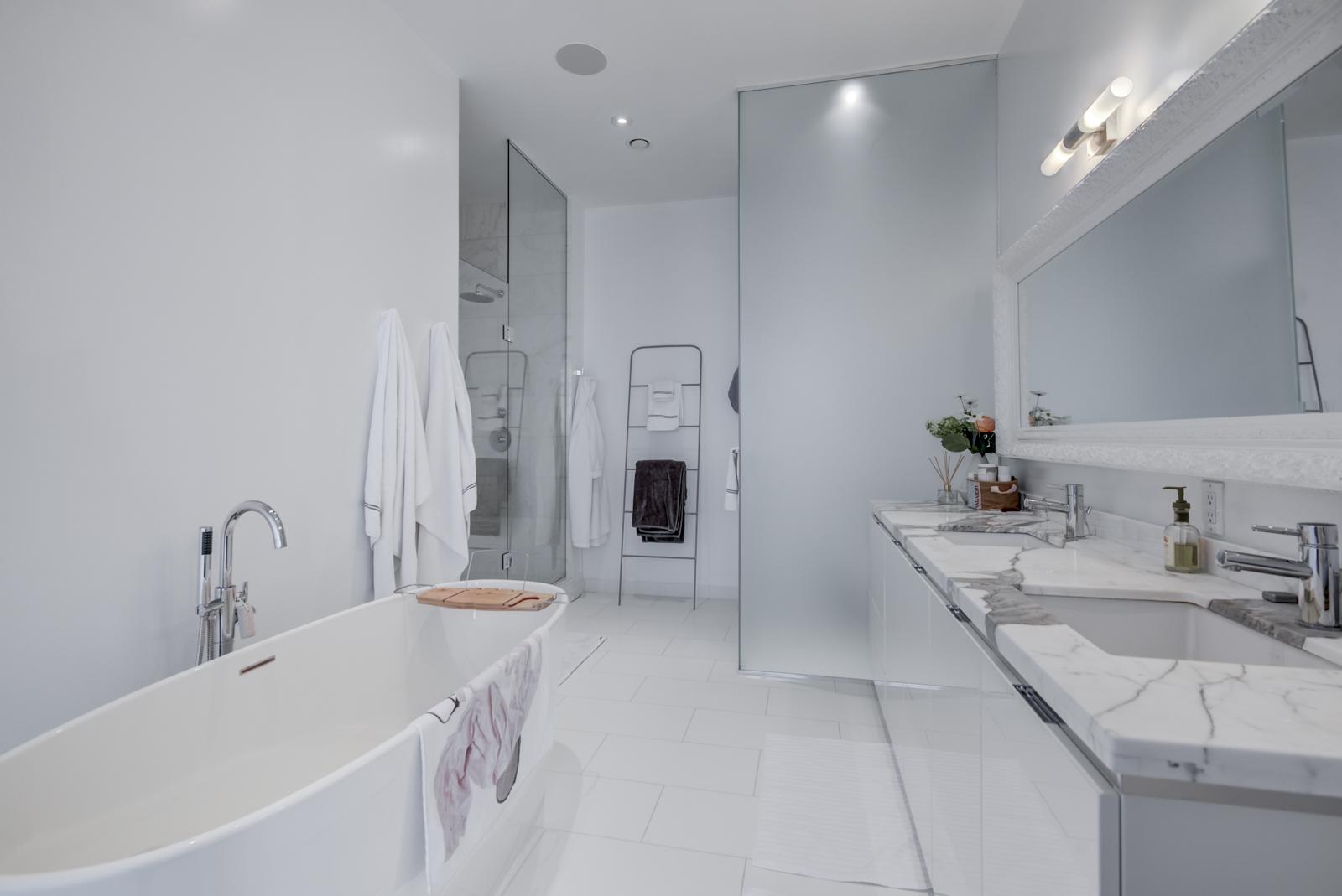 Casa Condo and its master bath.