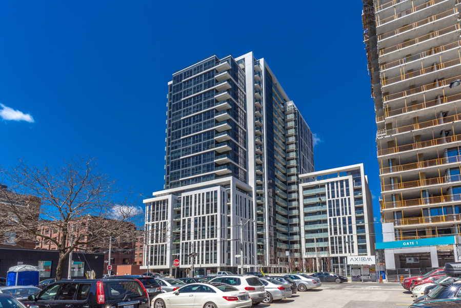 A photo showing 400 Adelaide Street East from the outside. and, first of all, also, another, furthermore, finally, and in addition.