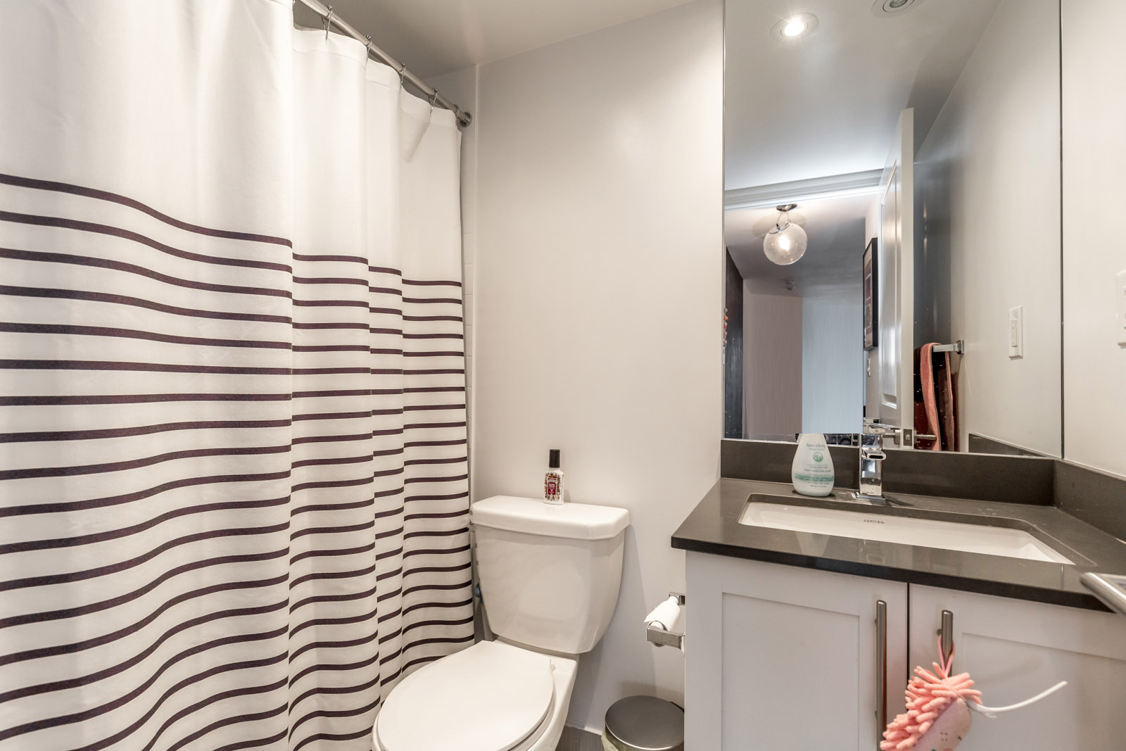 Photo showing a bathroom with crisp lines and clean layout