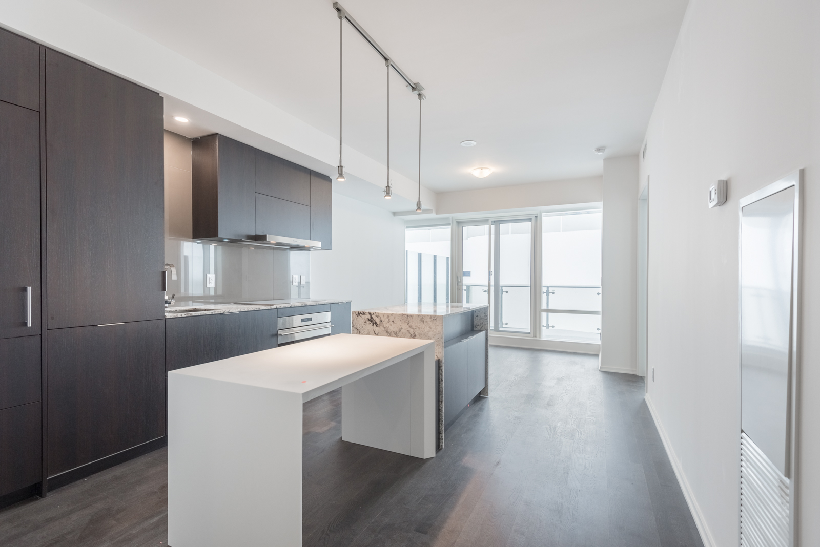Photo Of 1 Bloor Interior, Showing Kitchen, Dining And Also The Living Room. By Wins Lai, Toronto Real Estate Agent. So due to, while, since, therefore same, less, rather.