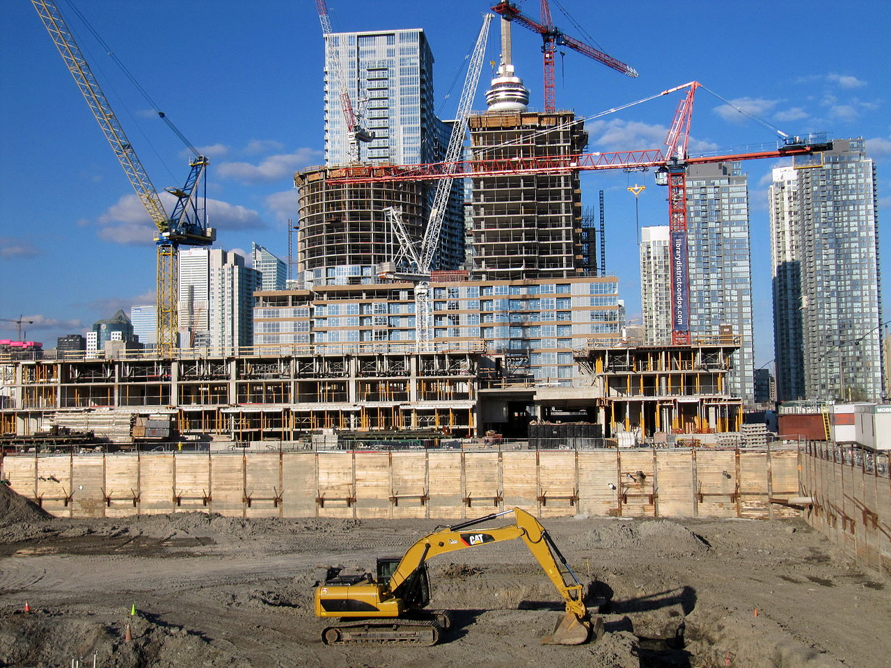 Photo showing construction in Toronto with CN Tower in the background. Blog by Wins Lai Toronto Real Estate Agent