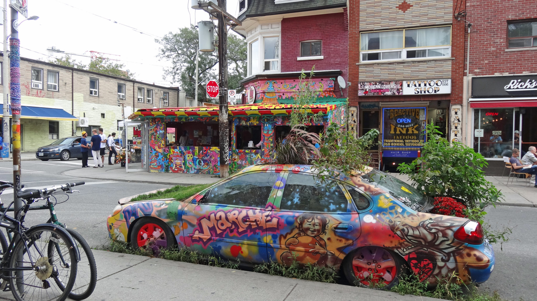 Photo of Kensington Market, streets and colorful car. Toronto Real Estate Agent.