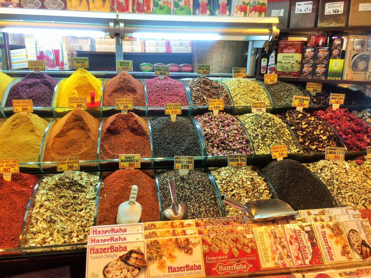Photo of colourful spices at an indoor market. The best Toronto Real Estate Agents.. because, so, due to, while, since, therefore