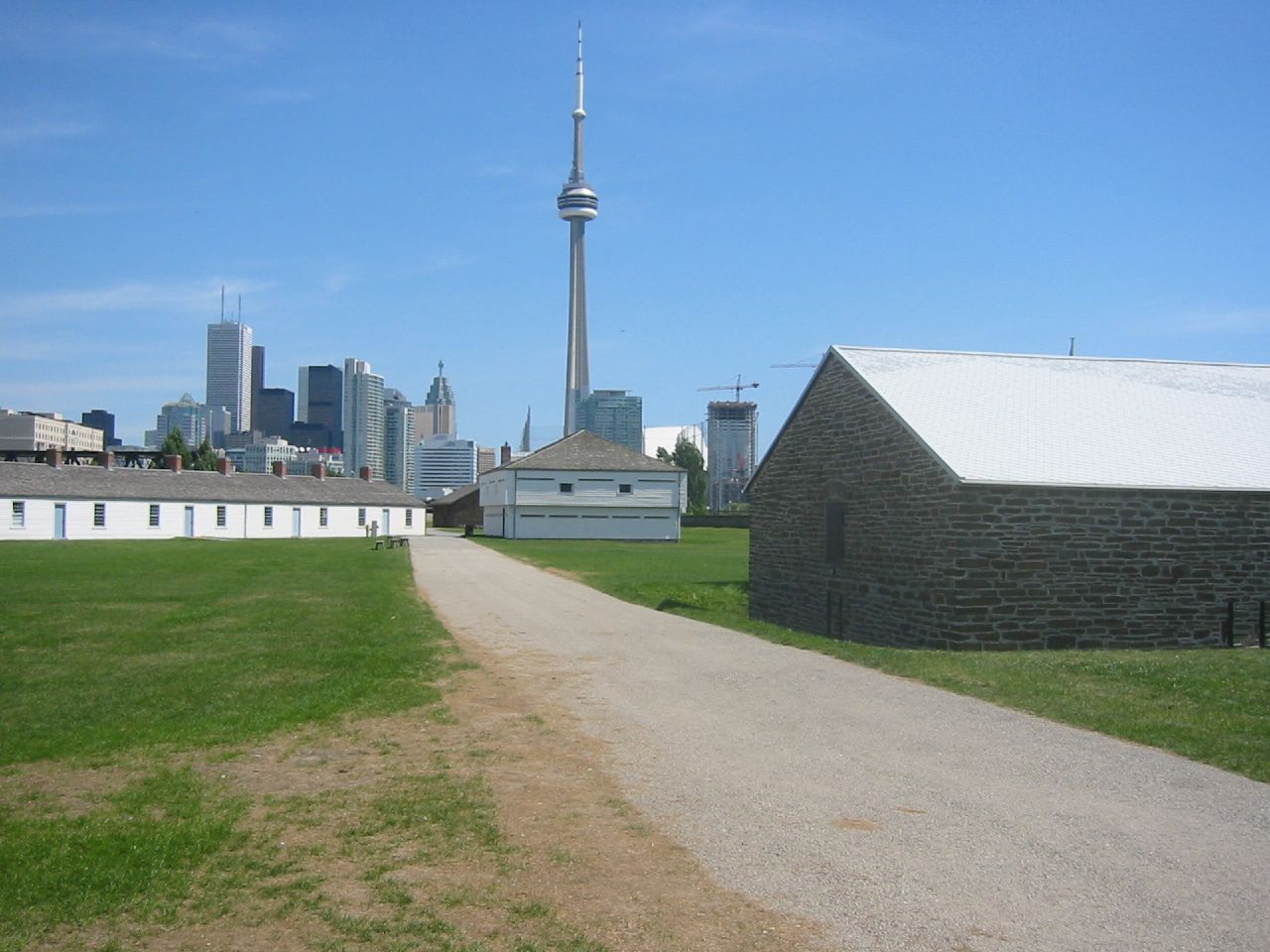 Photo shows Fort York, road, and also the CN Tower.
