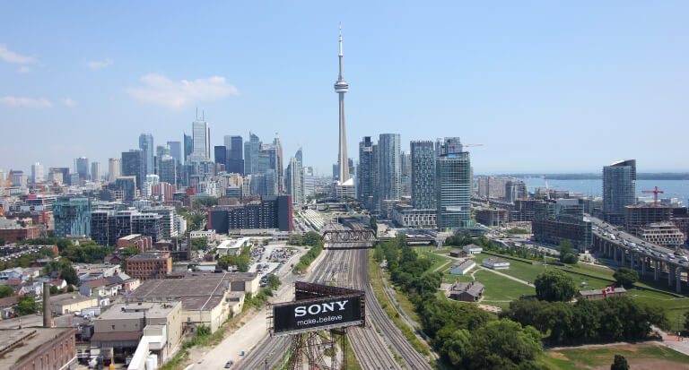 Toronto showing the CN Tower and highway, and so many other buildings. Though and, first of all, also, another, furthermore, finally, in addition because, so, due to, while, since, therefore the same and so no. While it's less, rather, while, yet, and so opposite in many ways.