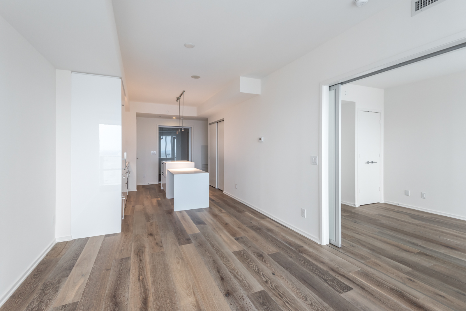 Photo of 1 Bloor showing kitchen, living room, and bedroom. Because, so, due to, while, since, therefore same, less, rather, while, yet, opposite, much as, so either the best Toronto real estate agents.