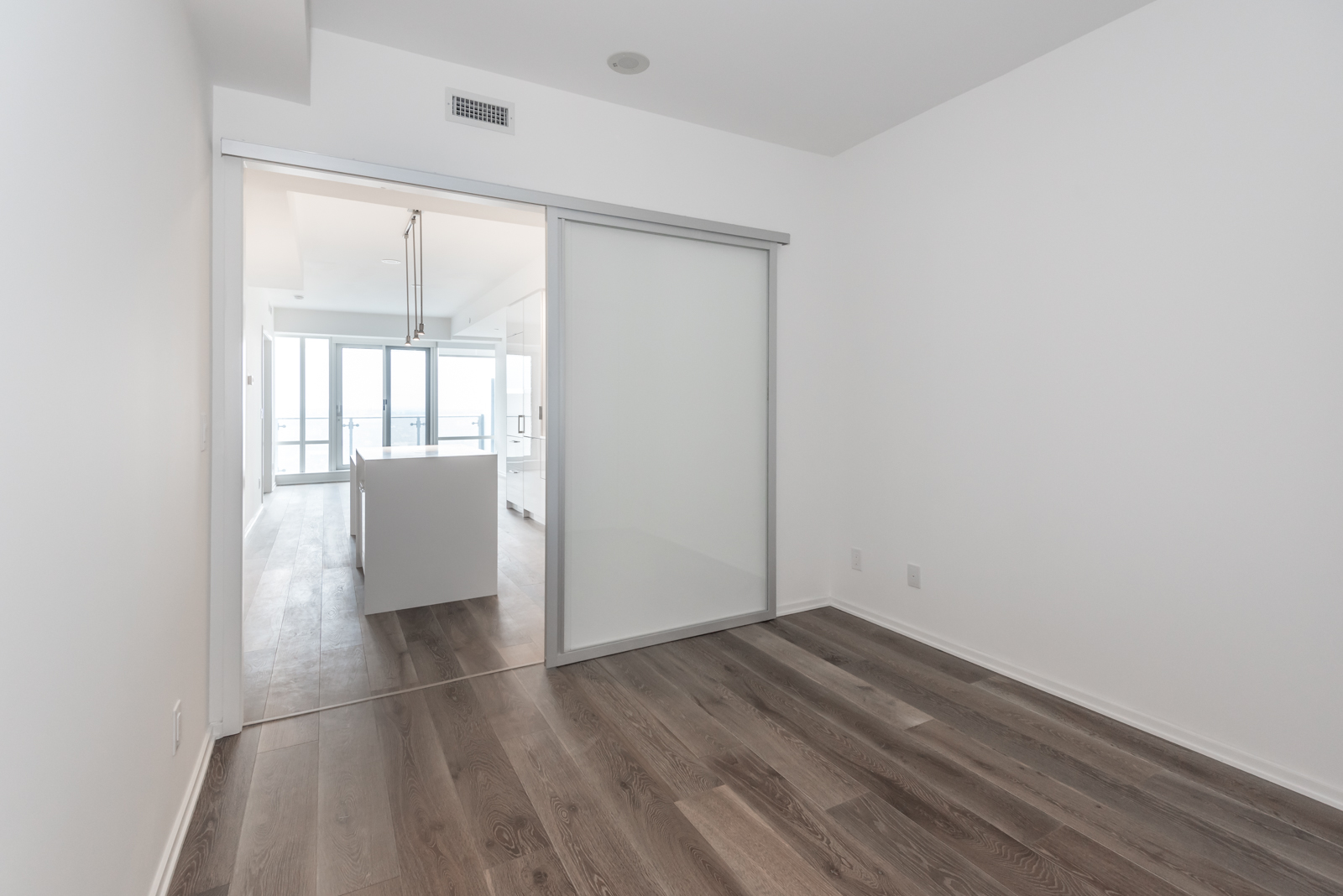 Photo showing bedroom, kitchen, and balcony. The best Toronto real estate agents same, less, rather, while, yet, opposite, much as, either as a result, hence and consequently.