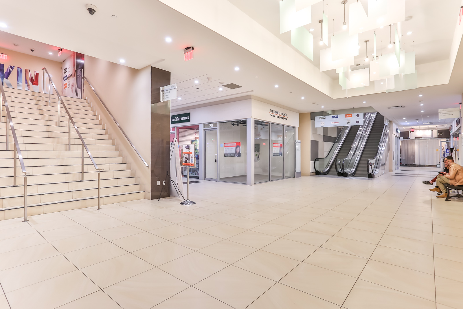 Photo of stairs and escalator with unit 20 at the centre.
