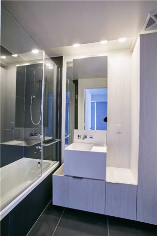 Shot of 1 Bloor Unit 3109 master bathroom. Everything is very geometric due to the sharp lines.