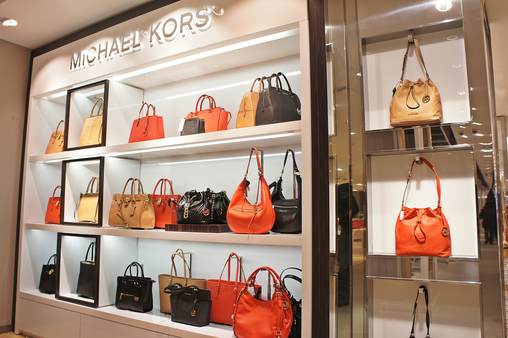 Photo of Michael Kors department store with purses.