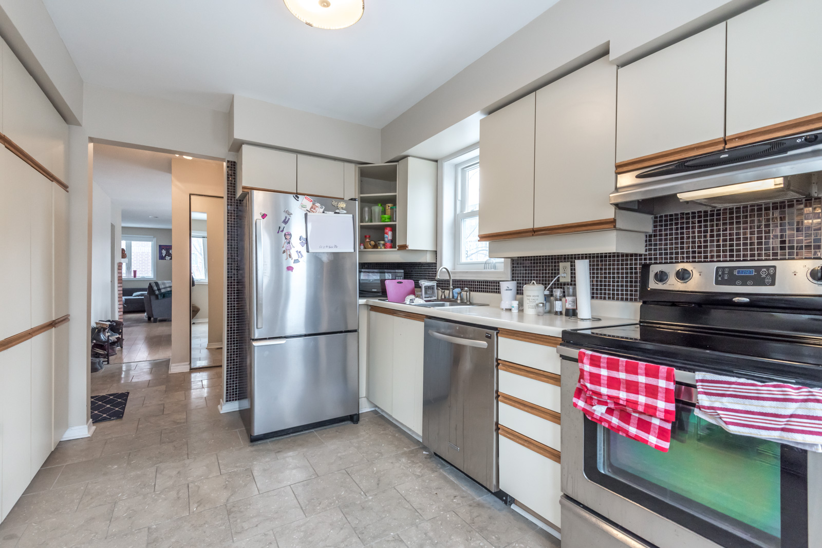 Multiple cabinets and drawers provide plenty of space for plates, utensils and smaller appliances.
