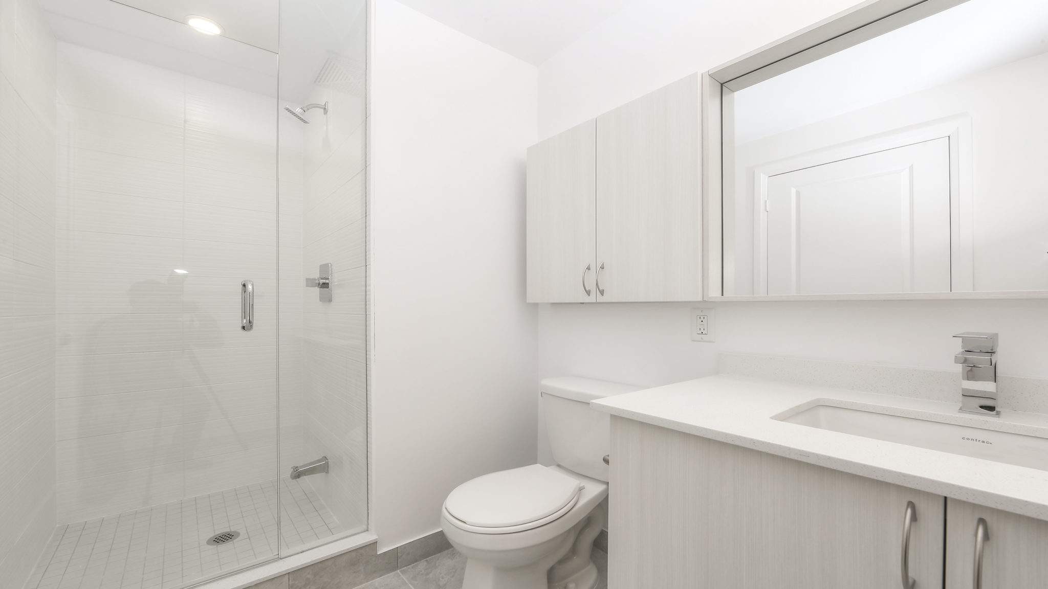 Image of master bath and shower, sink and mirror.