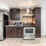 9 Keywest Avenue kitchen showing appliances and dark wooden cabinets.