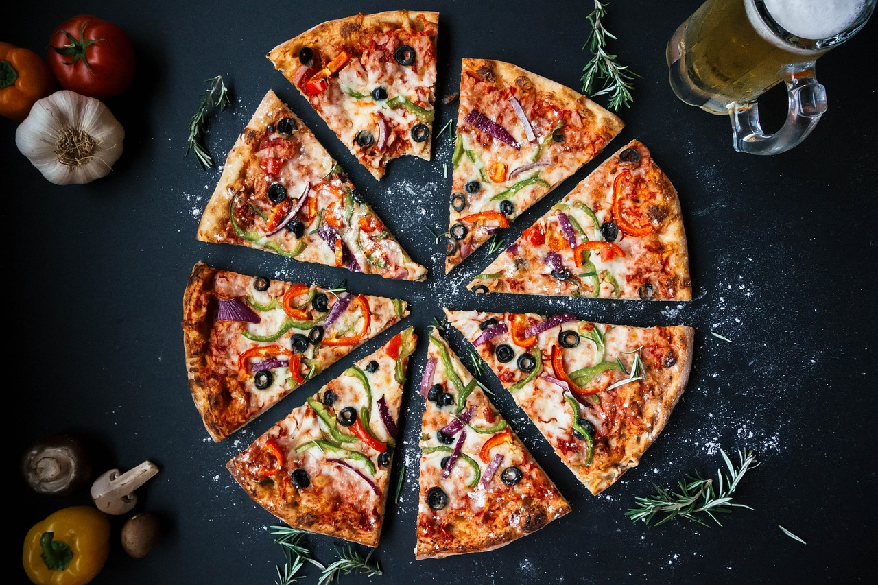 Picture of pizza cut into slices; it looks rather delicious.
