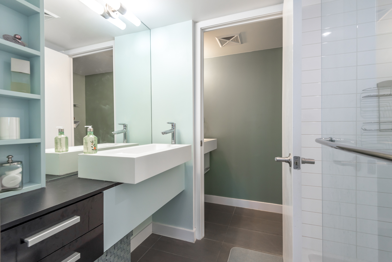Photo of master bath and sink and cabinets and drawers.