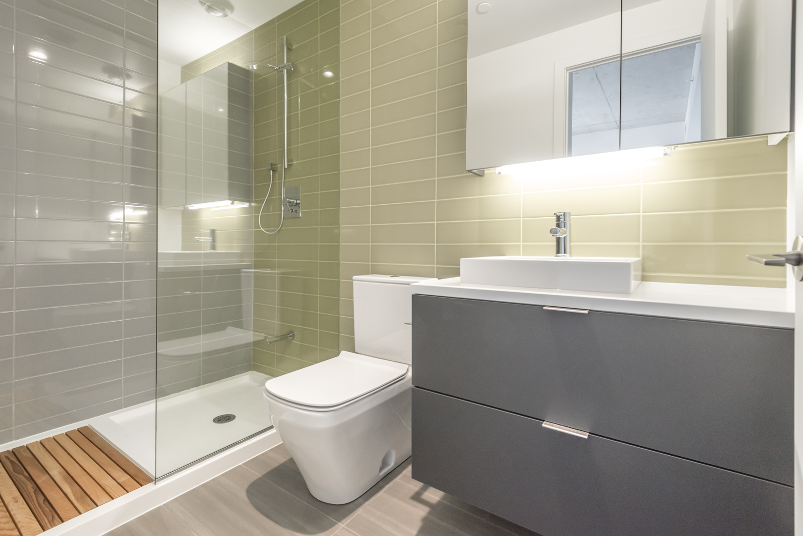Another bathroom pic, and this one is of second bathroom. It's less in size, but it's rather beautiful with its use of wood and colour. Also, the layout is rather striking.