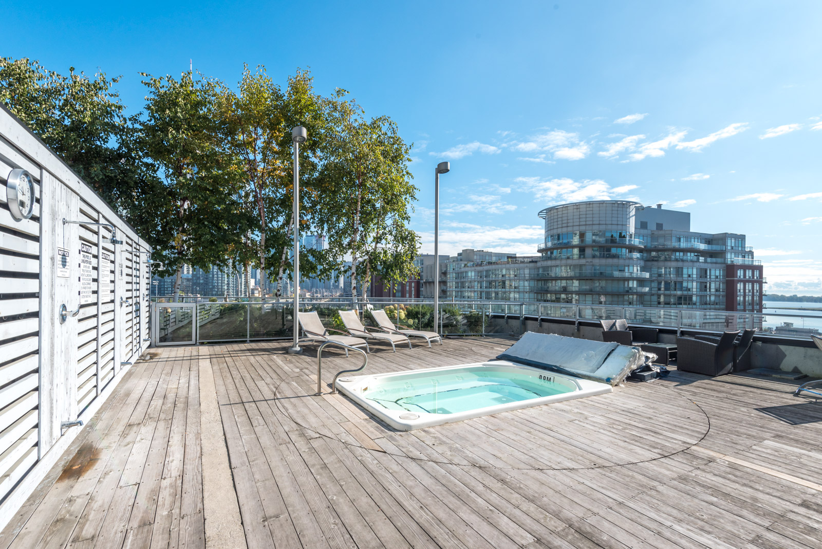 Picture of condo's roof and also hot-tub and chairs.