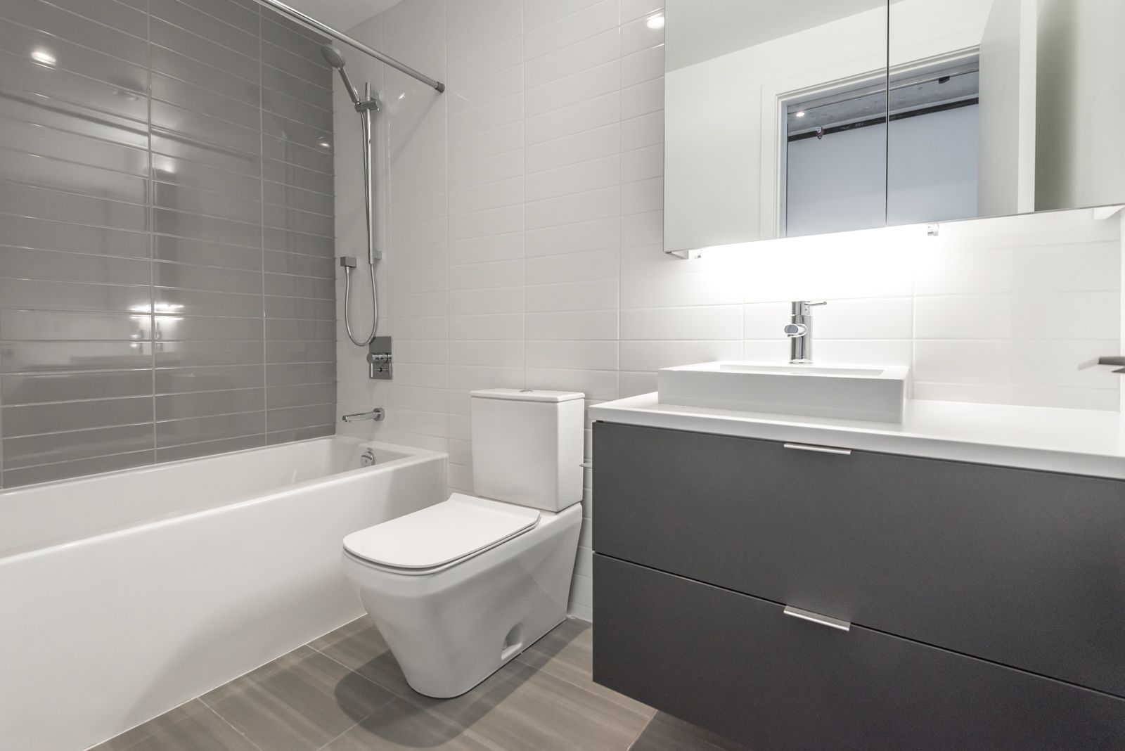 Lovely photo of master bath and tub, sink, and more.