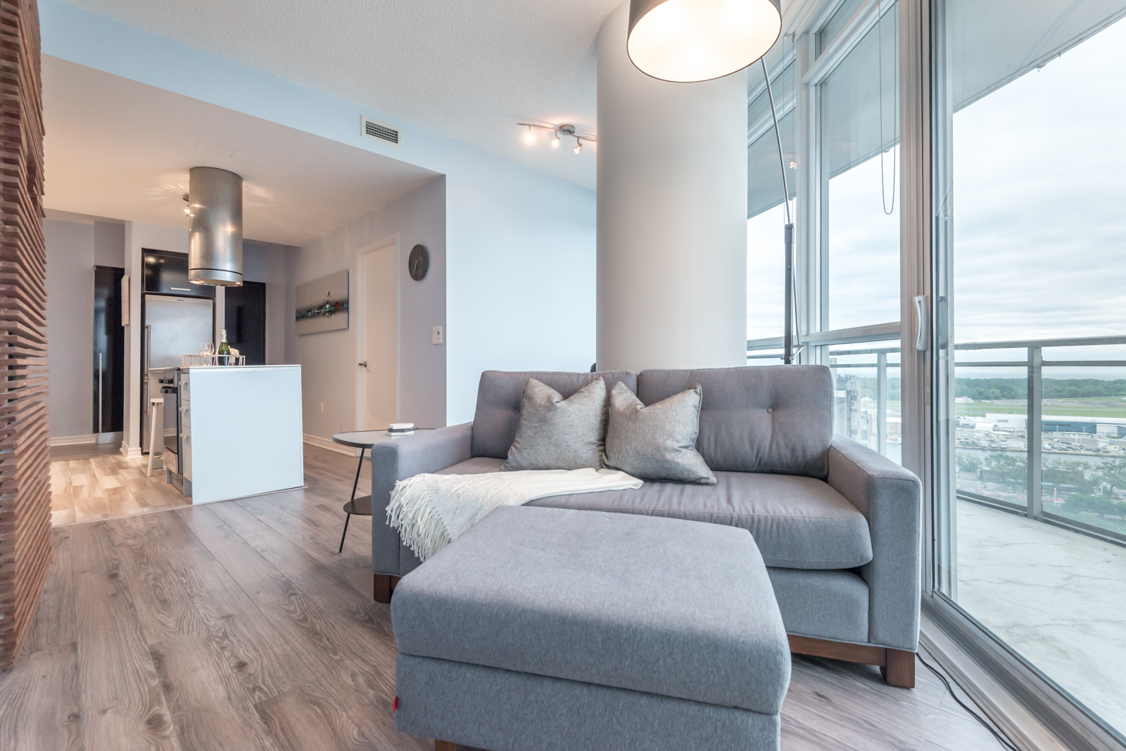 Image of condo's rather tall ceilings and we also see kitchen in background.