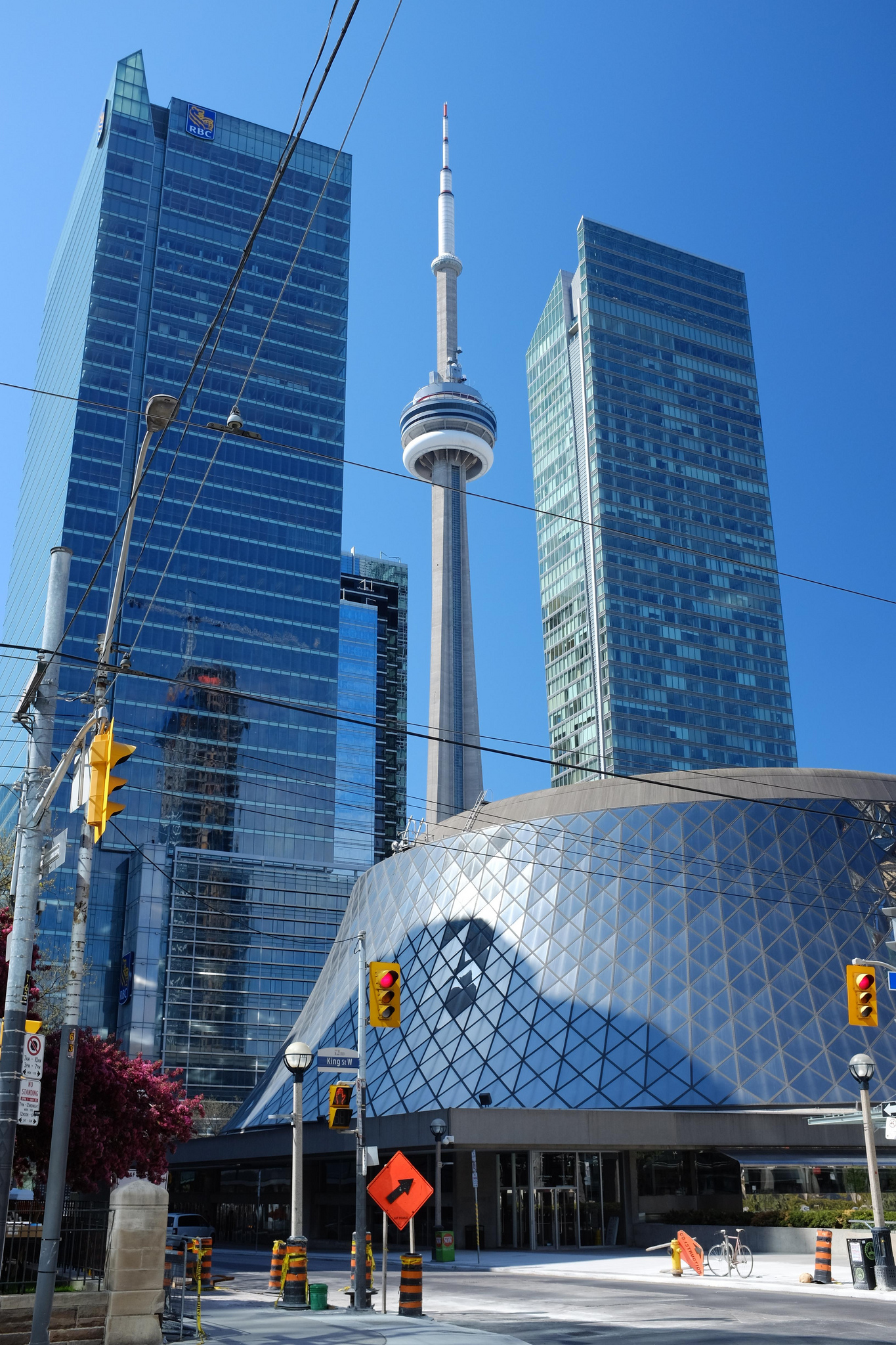 A photo of Roy Thompson Hall and CN Tower in Toronto's Fashion District.