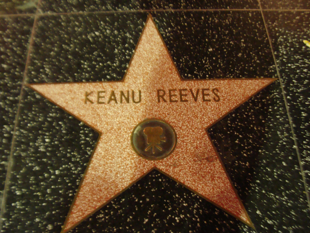 Photo of Keanu Reeves' Walk of Fame Star and black background.