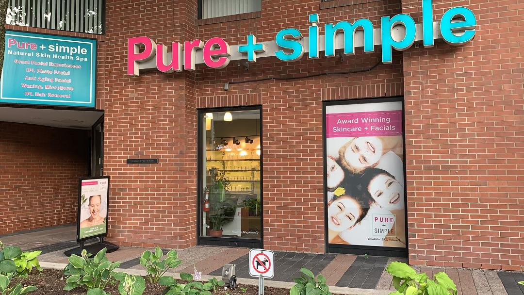 Red-brick exterior of Pure + Simple spa on King Street Toronto.