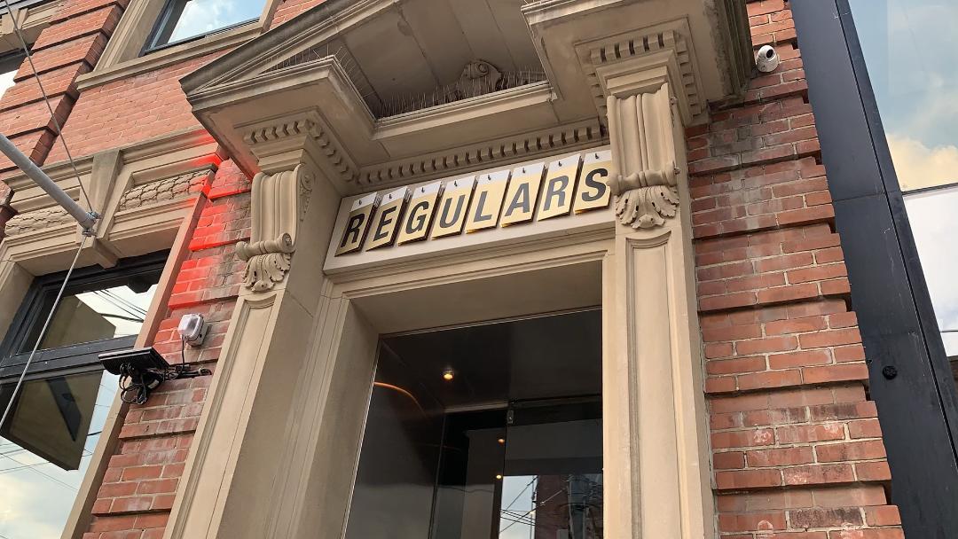 Fancy beige columns with name REGULARS.