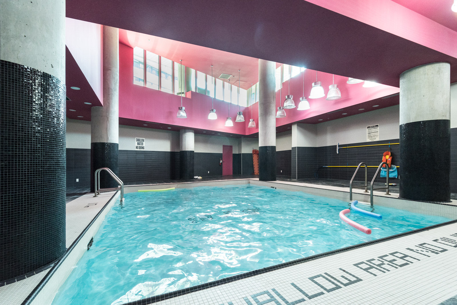 Here we see the condo pool and its sparkling blue water and rather pinkish walls.