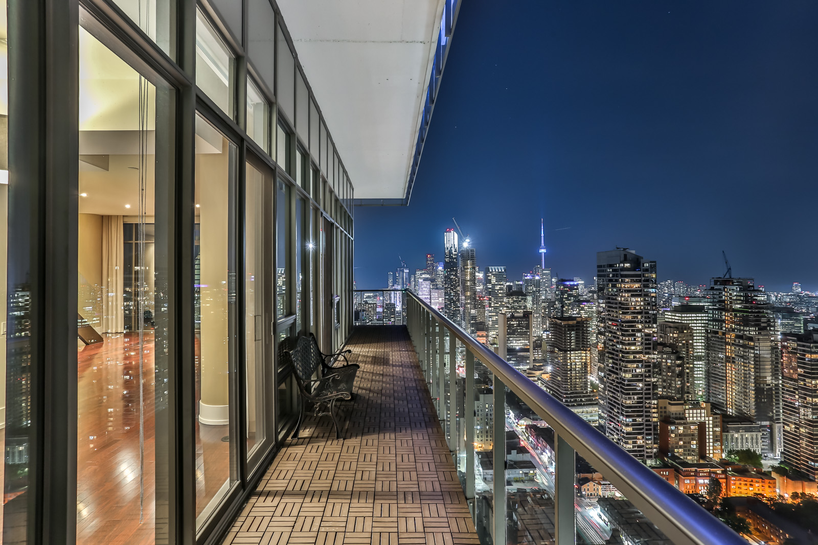 Another exterior shot; this one shows the balcony and Toronto at night.