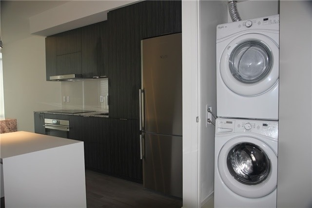 Photo of 1 Bloor Unit 3109 laundry closet with washer and dryer.