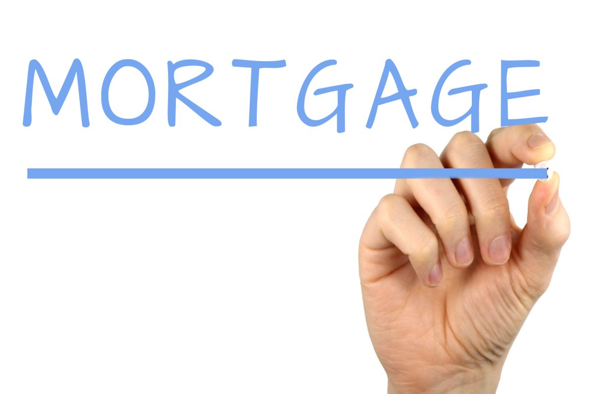 Image of word mortgage and a hand under it.