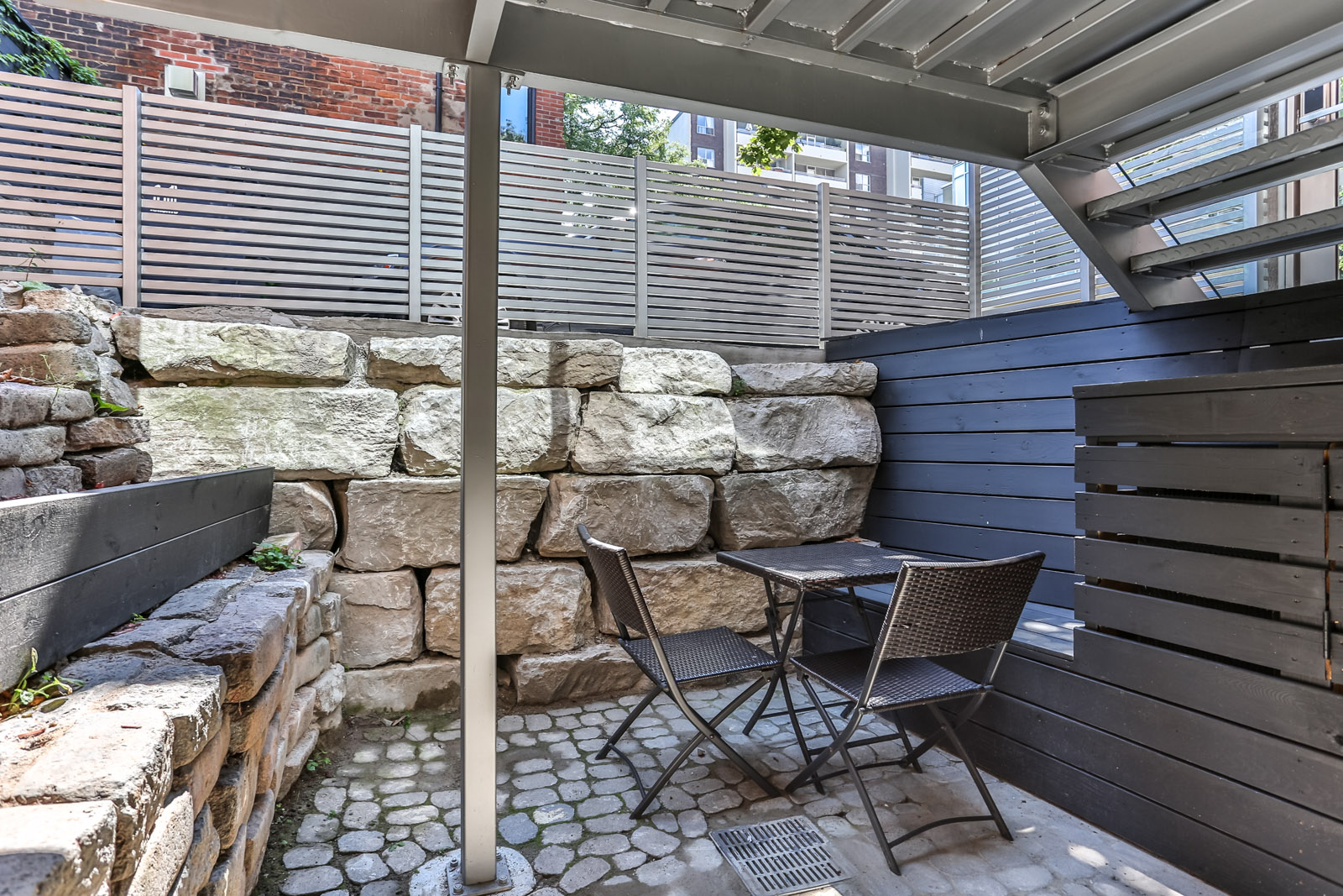 115 Maitland Street patio and brick wall.
