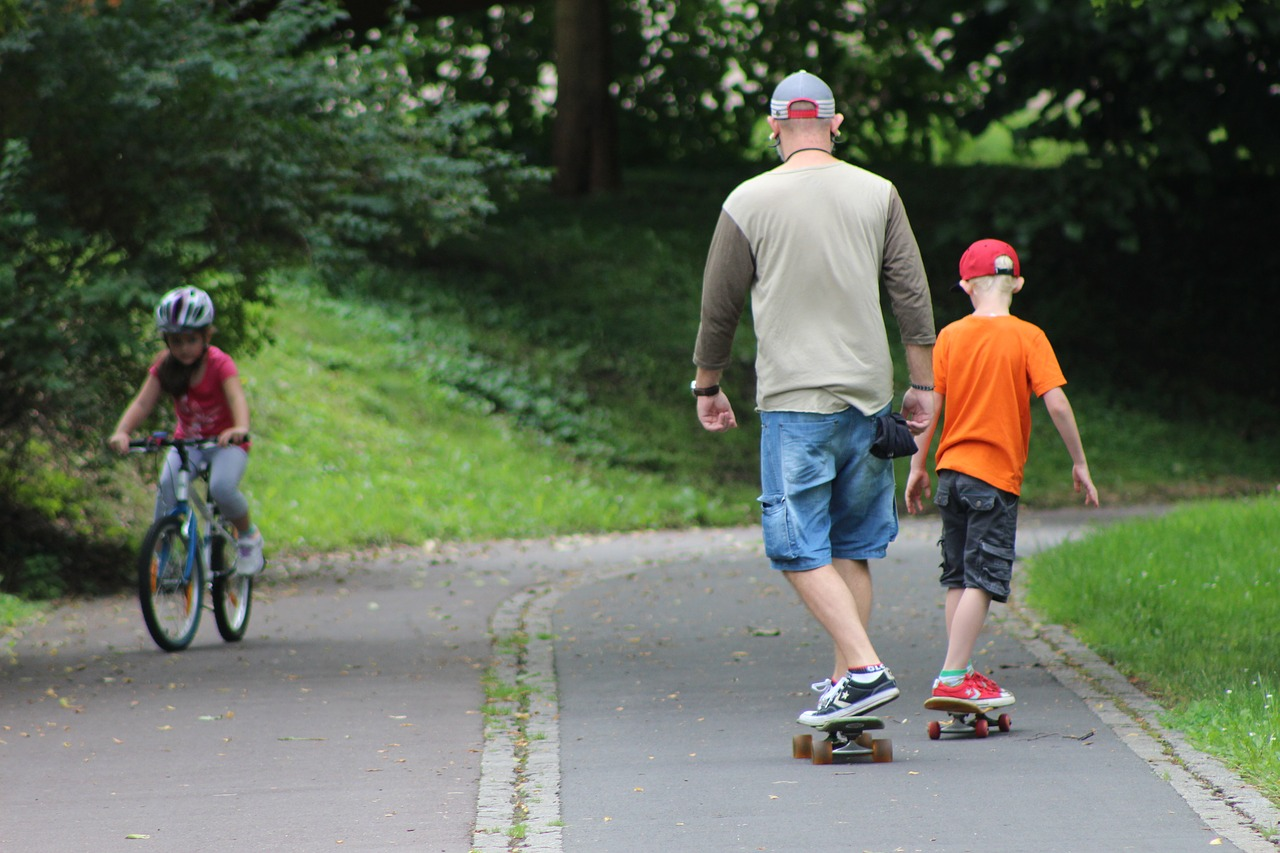 Another image of green-spaces. This one shows father and son skateboarding, showing how family-friendly the neighbourhood is.