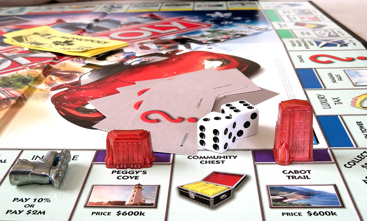 Monopoly board with dice and pieces