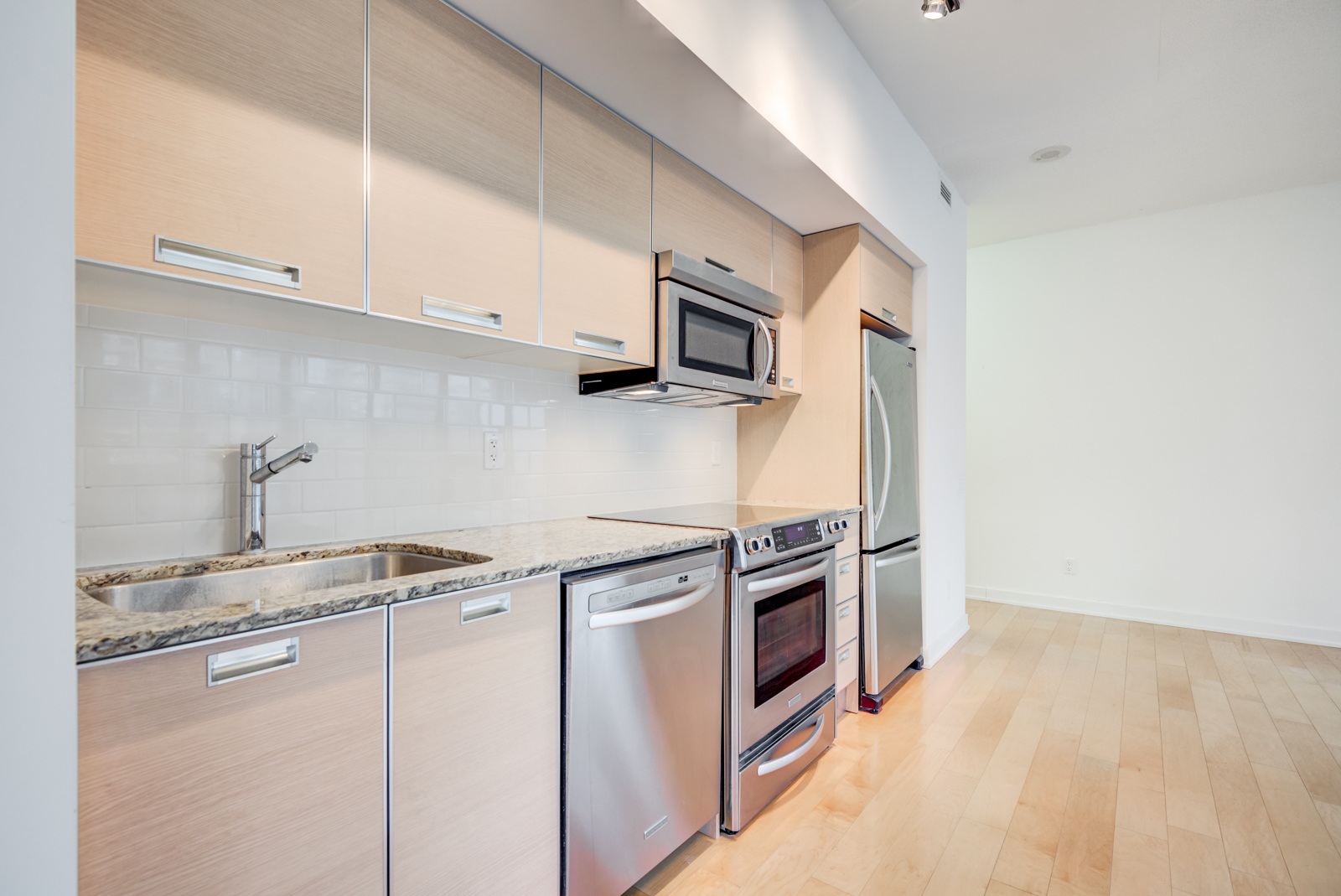 Another kitchen photo; close-up of cabinets and appliances.