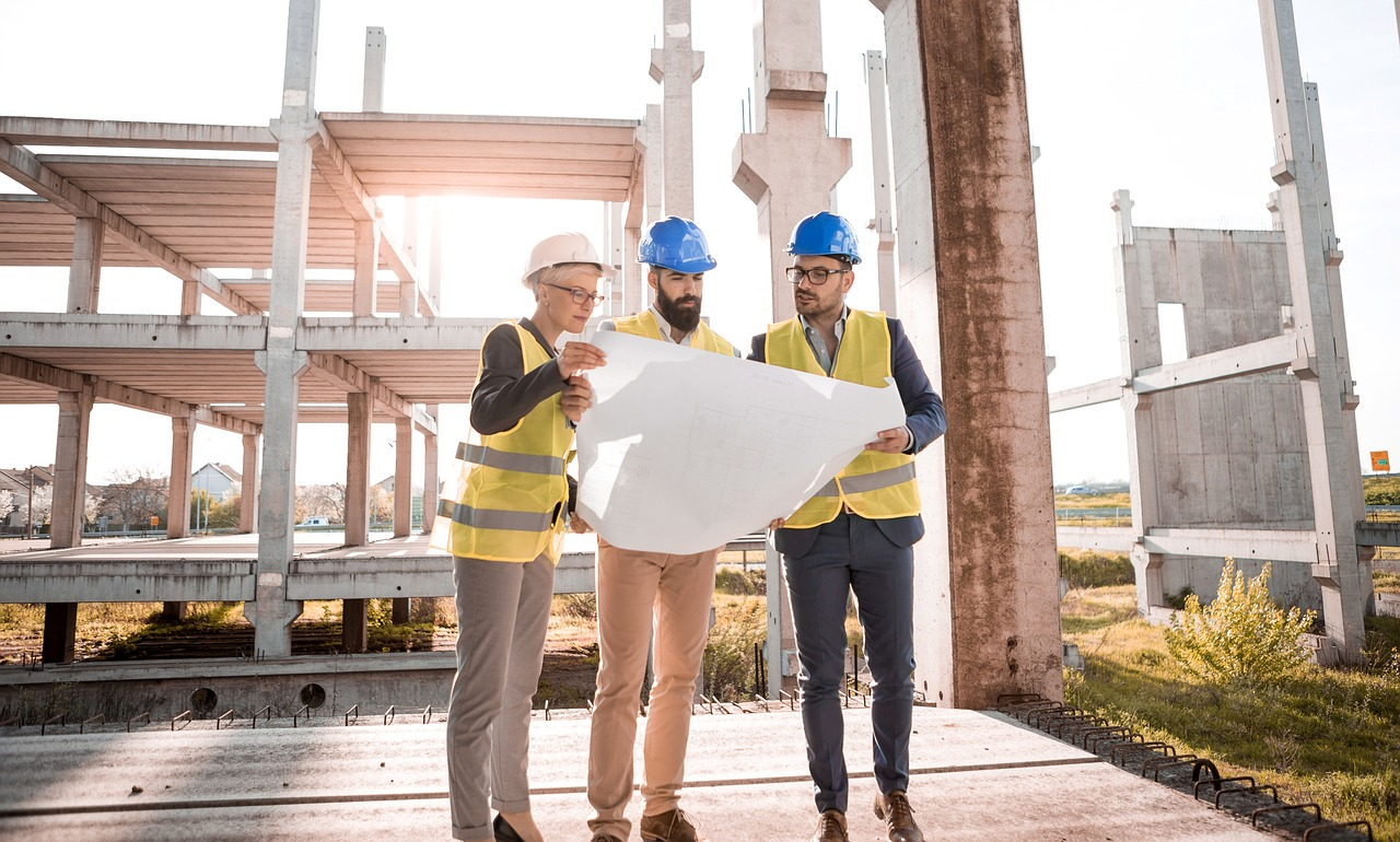 Builder and planners at build site