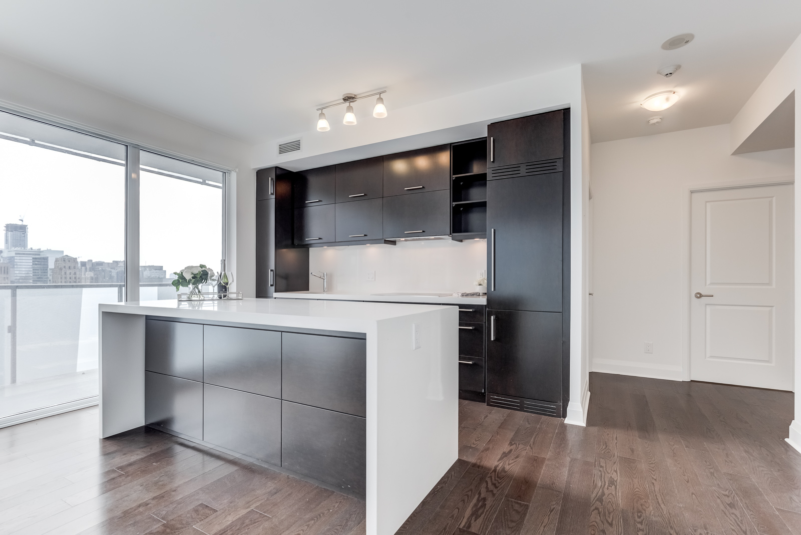 Image of kitchen island in front and kitchen cabinets in back.