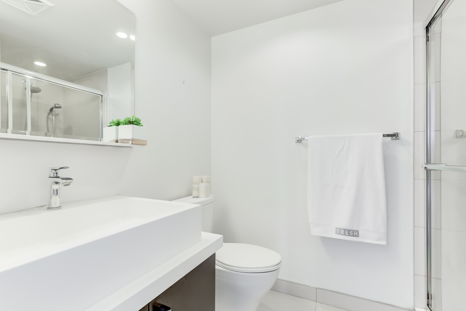 2nd bathroom with sink, shower and vanity.