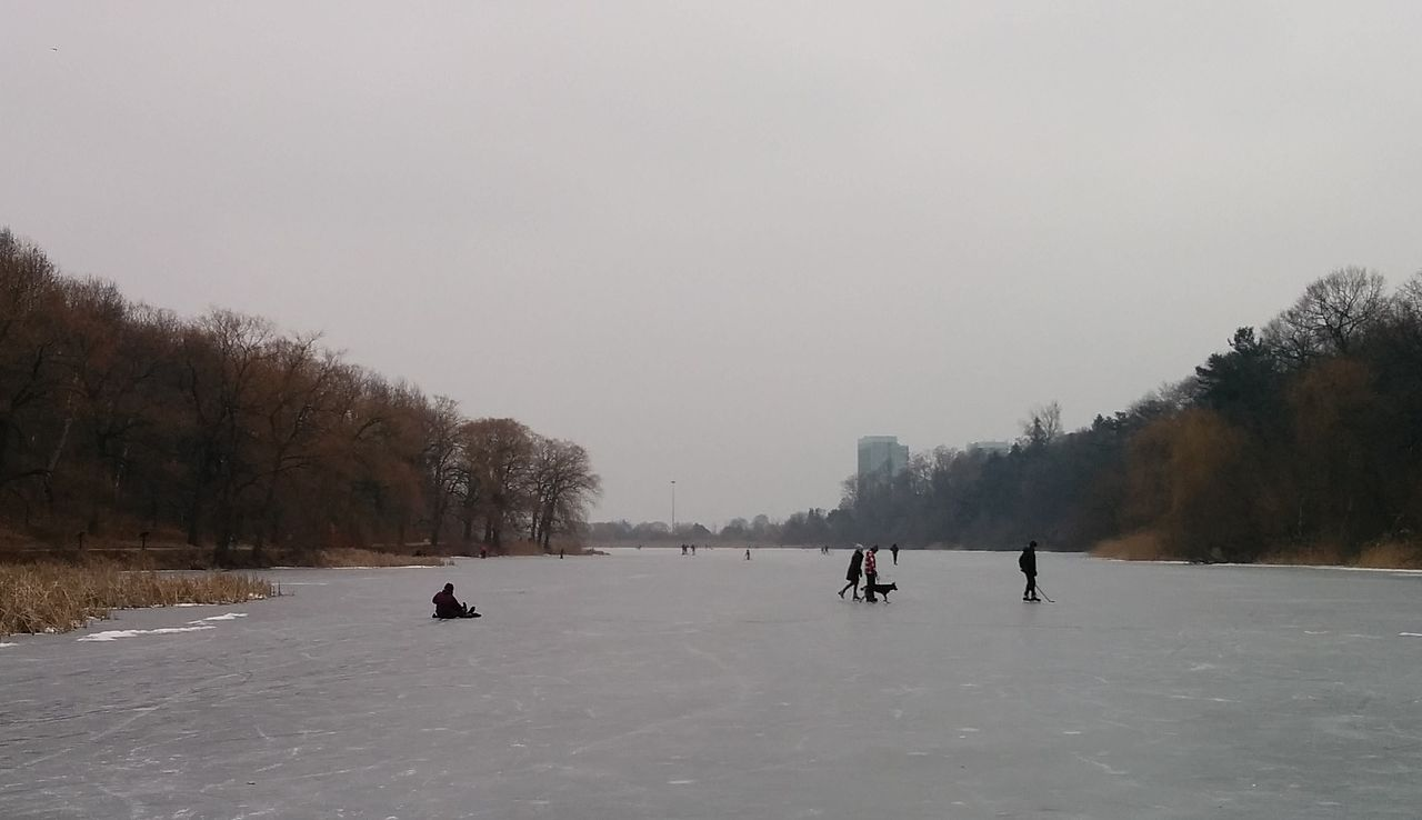 People ice-skating at High Park in Toronto.
