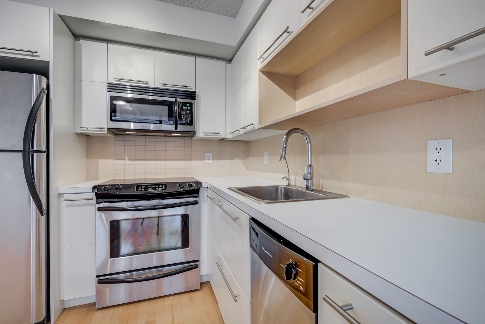 Another close up of 25 Carlton St Unit 401 counters and appliances.