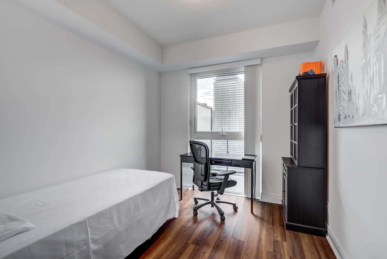 Second bedroom, bed and work desk of 28 Ted Rogers Way Unit 3609.