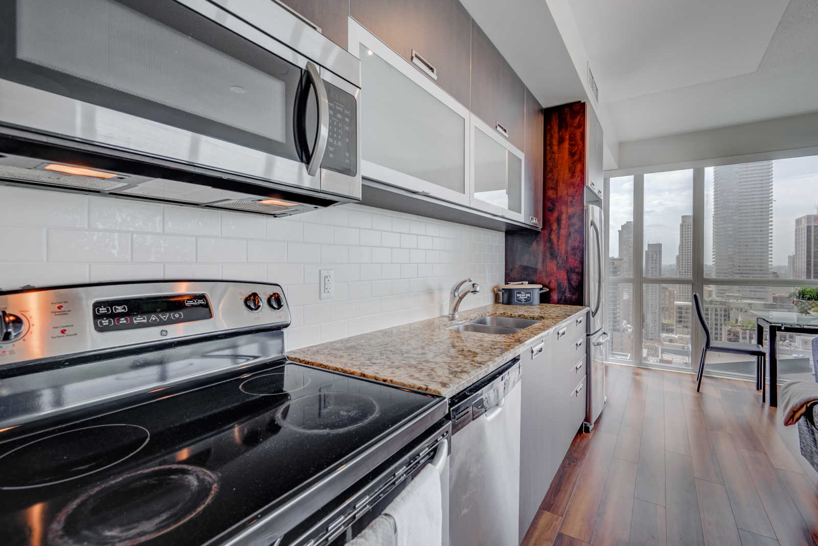 Close up of 28 Ted Rogers Way Unit 3609 kitchen counters and appliances.