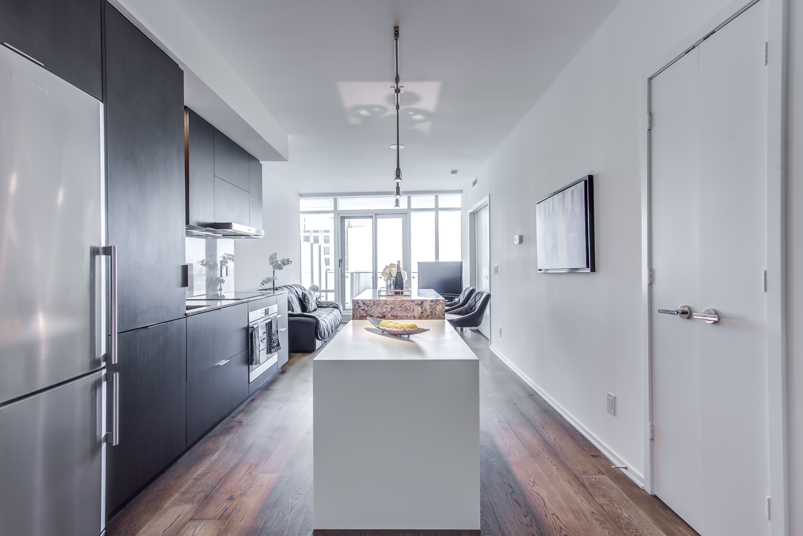 Dining table and kitchen of 1 Bloor St E Unit 3408.