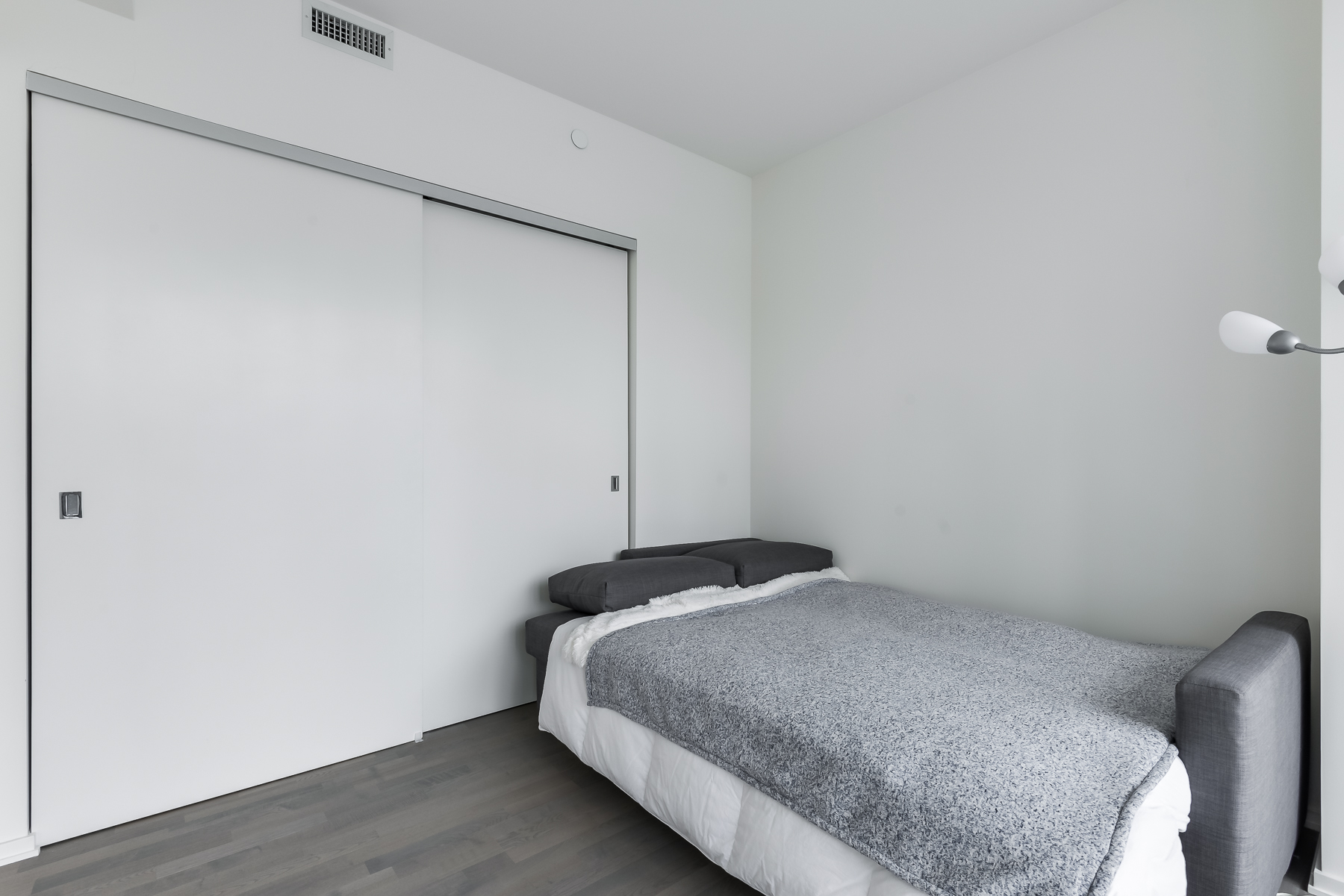 Closet and bed - 1 Bloor St E Unit 310 Toronto.
