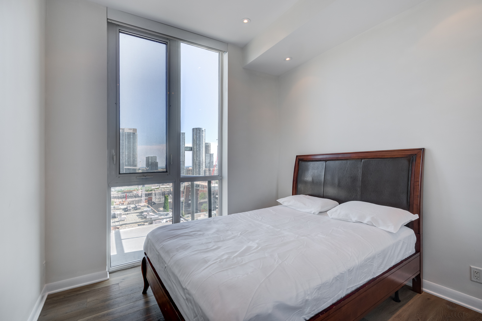 2nd bedroom and window view of Victory Lofts Penthouse Suite in 478 King St W Toronto.