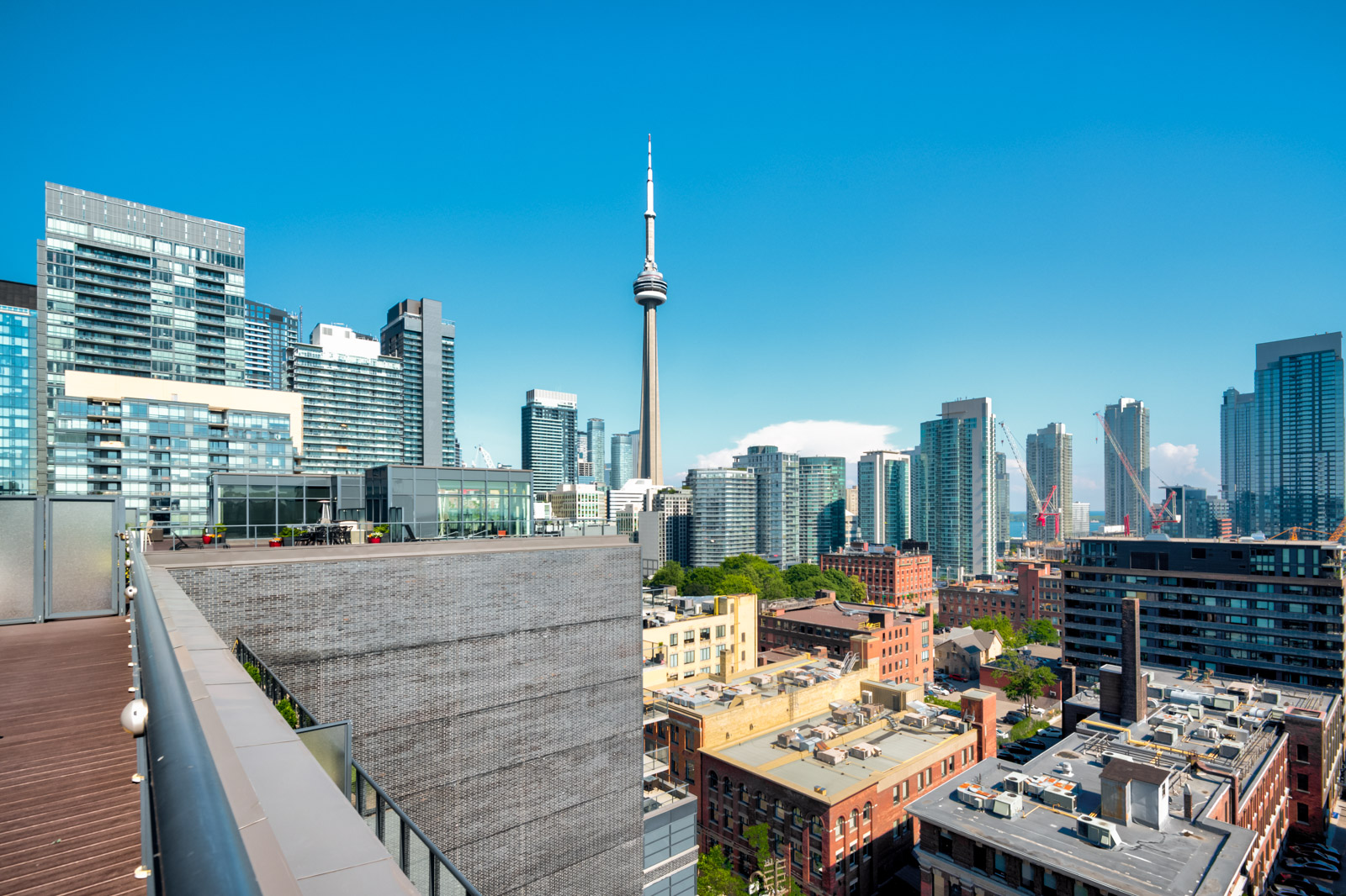View of CN Tower and Toronto from terrace of Victory Lofts Penthouse Suite in 478 King St W Toronto.