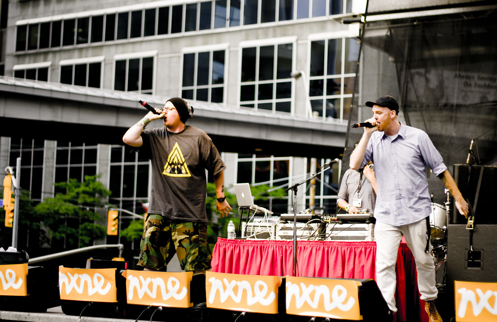 Two musicians on stage at NXNE concert in Yonge-Dundas Square.