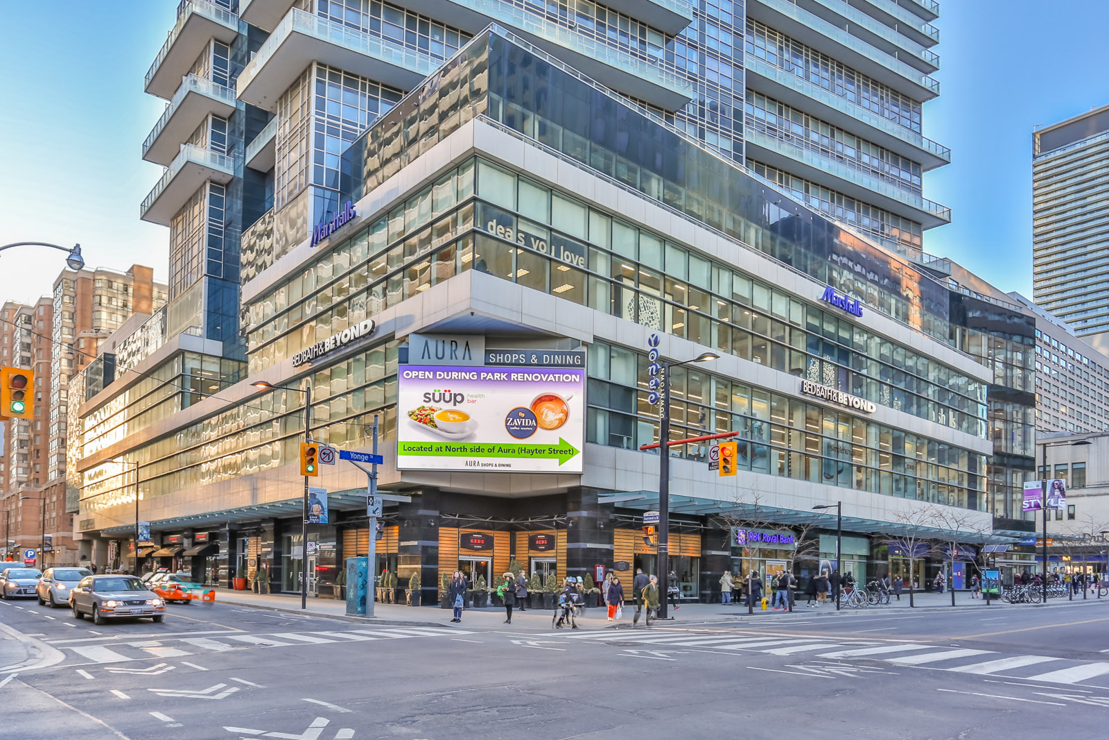 Street view of Aura at College Park condo and mall in Toronto.