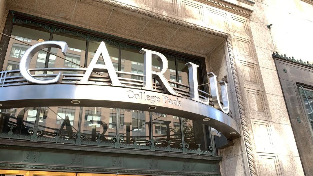 Closeup of The Carlu sign over door.