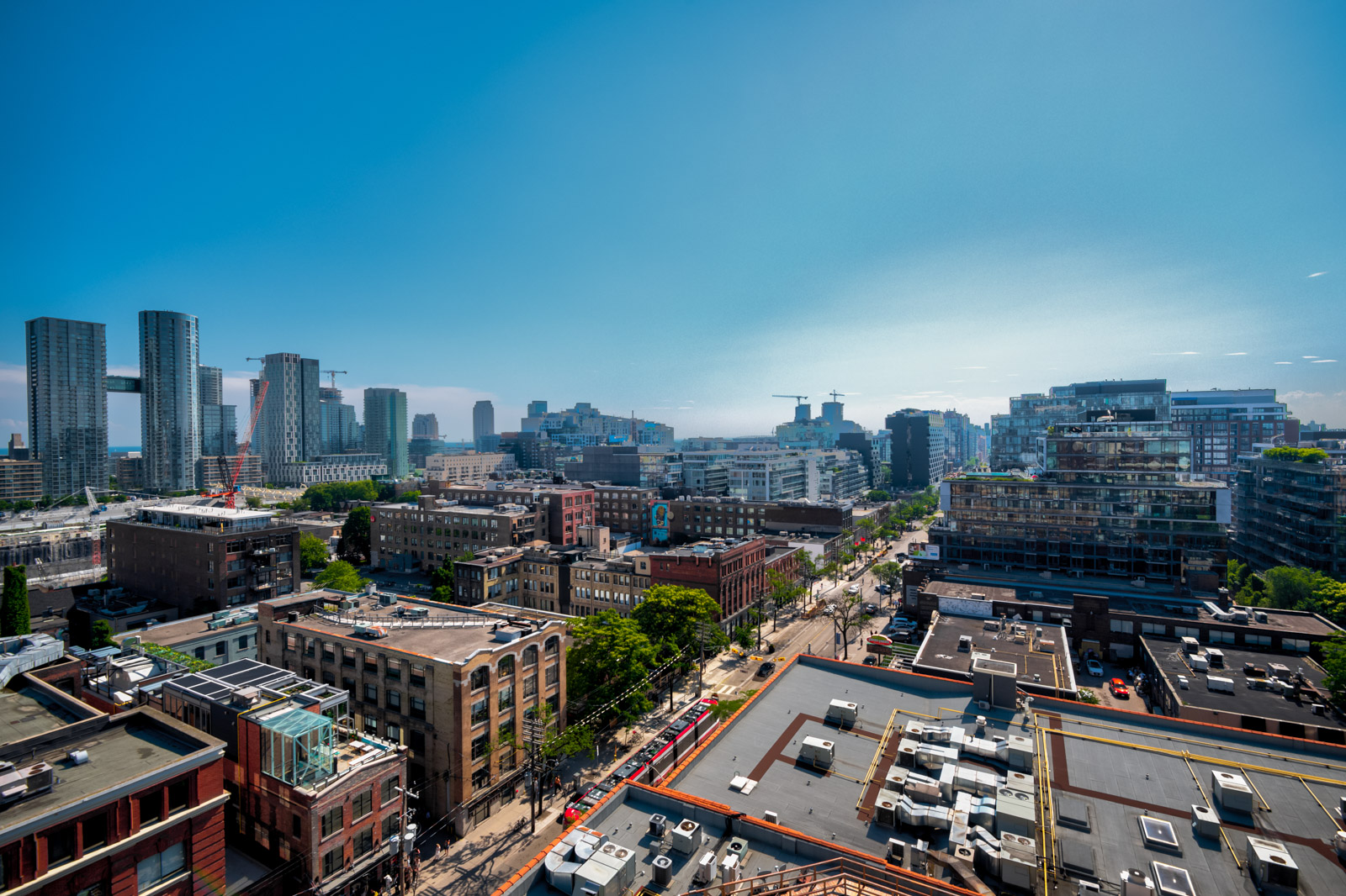 Daytime view of King St W, Toronto from Victory Lofts rooftop.